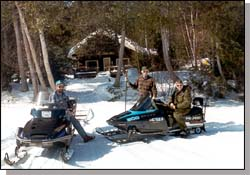 Macannamac Ice fishermen since 1995 from central Maine take some time to visit out in front of camp.